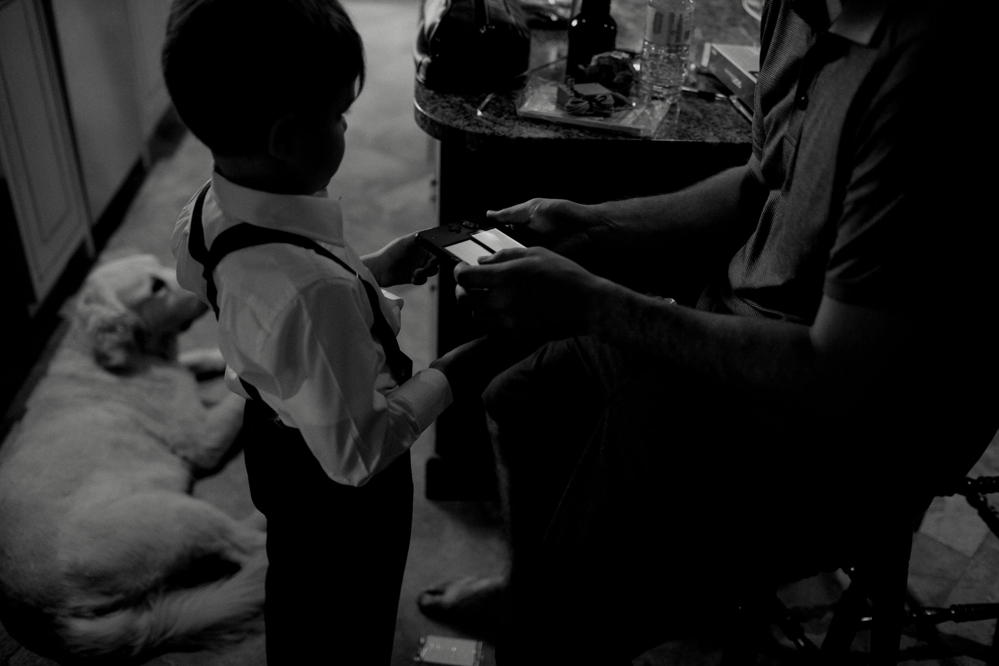 wedding ring bearer playing video games