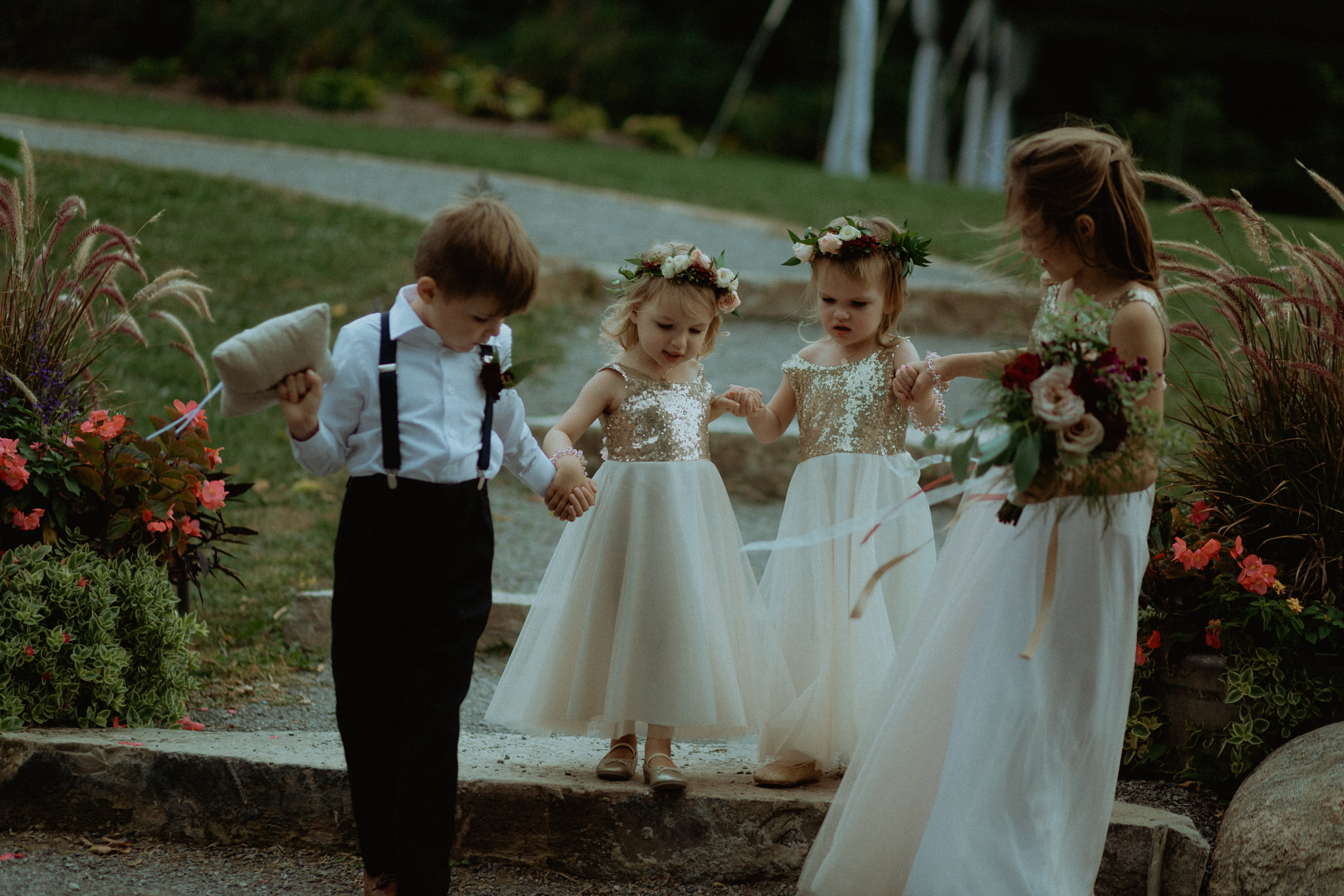 Ring bearer and flower girls entrance wedding photography outdoor barn venue peterborough