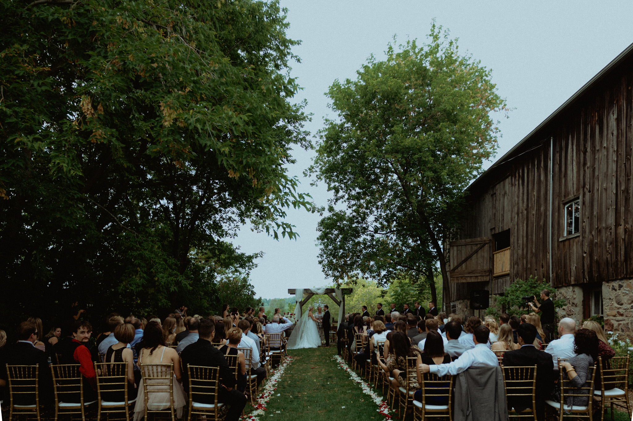 Century Barn Weddings outdoor ceremony location setup cavan ontario photographer