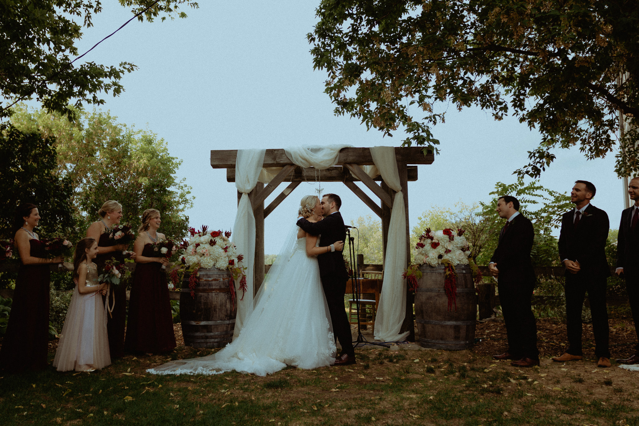 first kiss outdoor rustic wedding ceremony