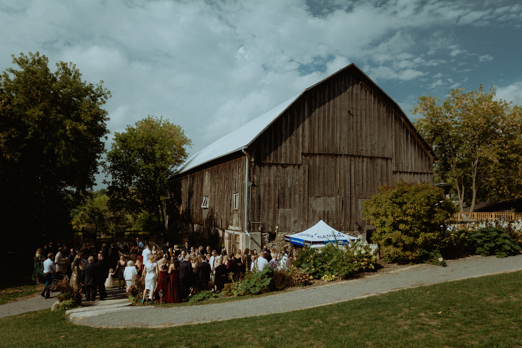 century barn weddings cocktail hour guests gathering wedding photgraphy peterborough cavan ontario