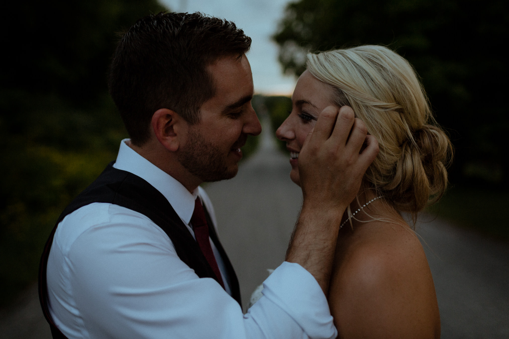 couple kissing on street peterborough wedding photographer