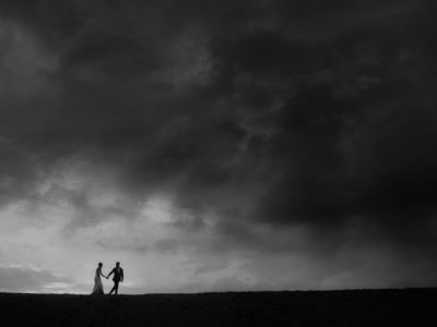 Epic landscape couple Portraits Stormy Sandbanks Provincial Park Wedding