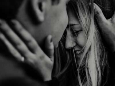wildly romantic close up of girl with fiancé cozying up